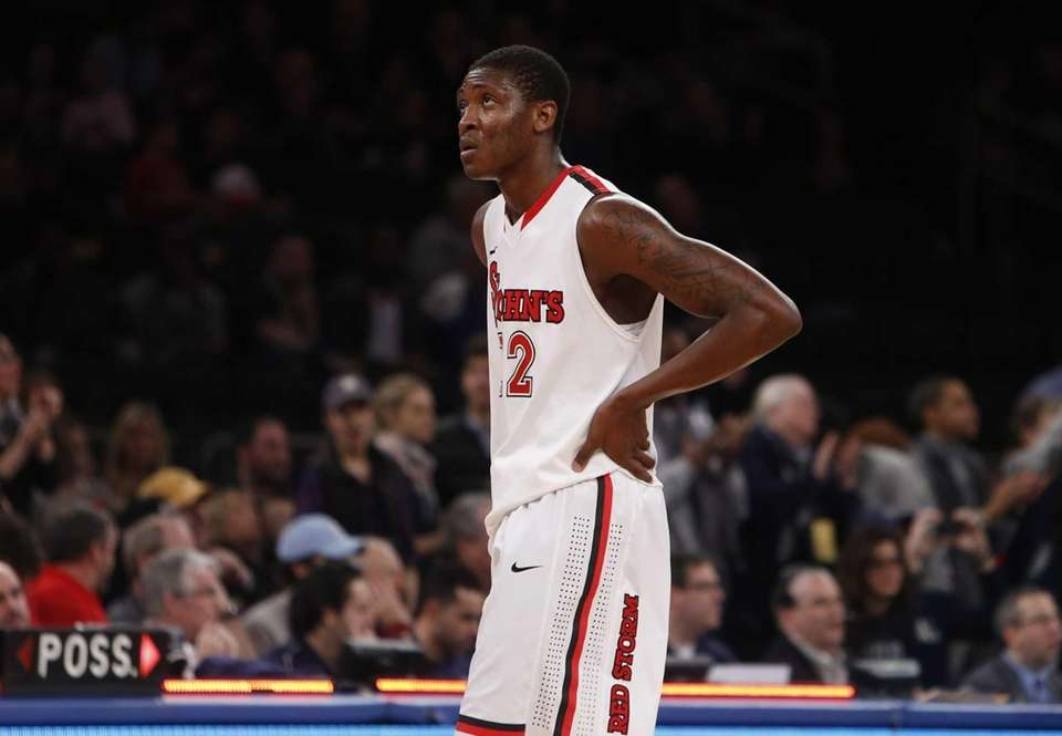 St. John's Chris Obekpa reacts after the Red