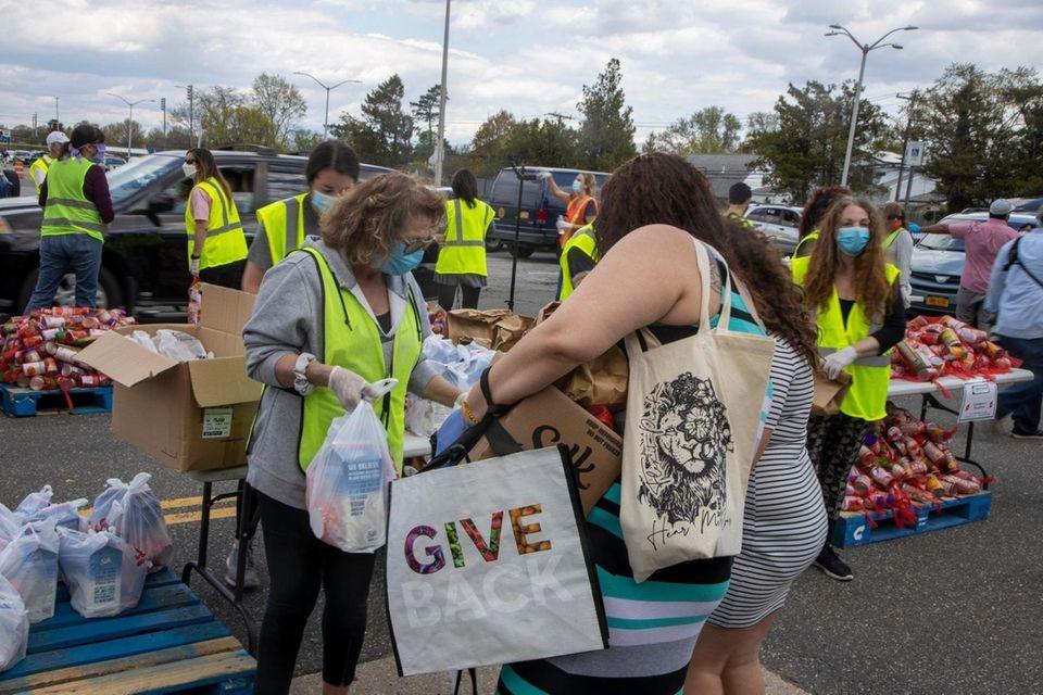 Volunteers with Island Harvest distribute food on Monday,