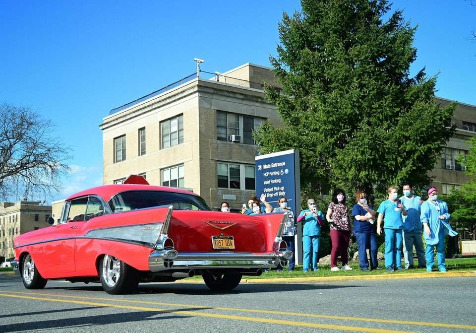 A parade of classic cars greet healthcare workers