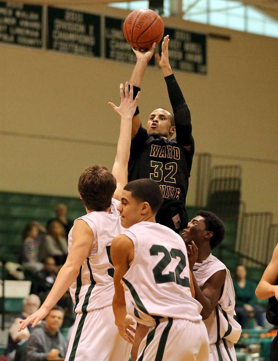 Ward Melville's Jesse Smith puts the shot over