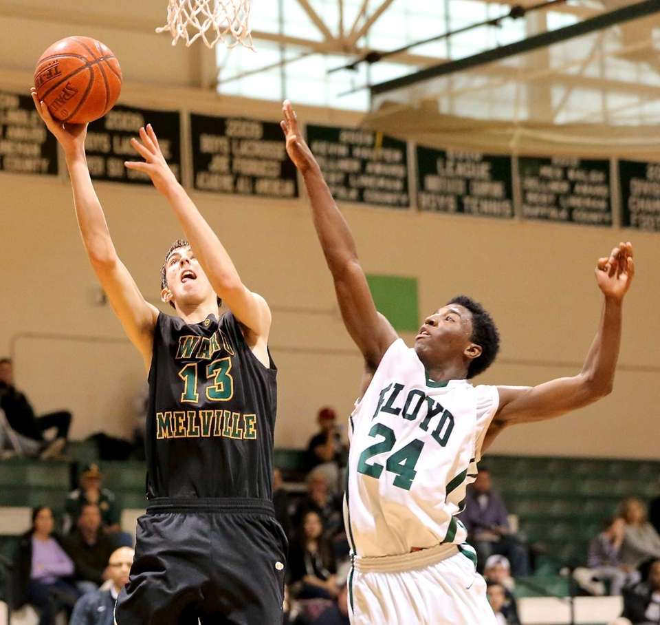 Ward Melville's Russell Winters moves in for the