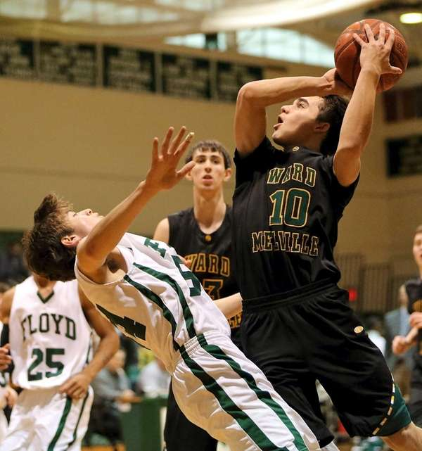 Ward Melville's Brandon Hart drives the lane against