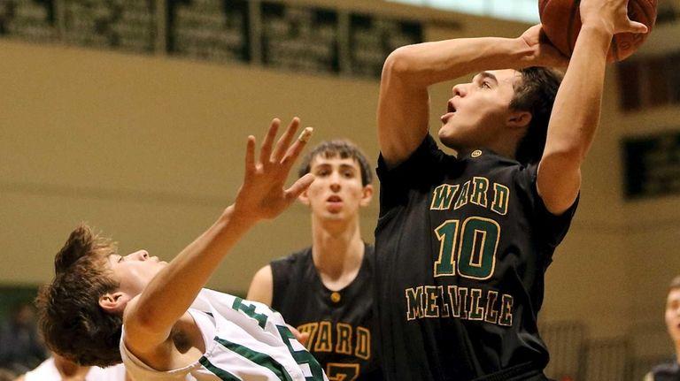 Ward Melville's Brandon Hart drives the lane against
