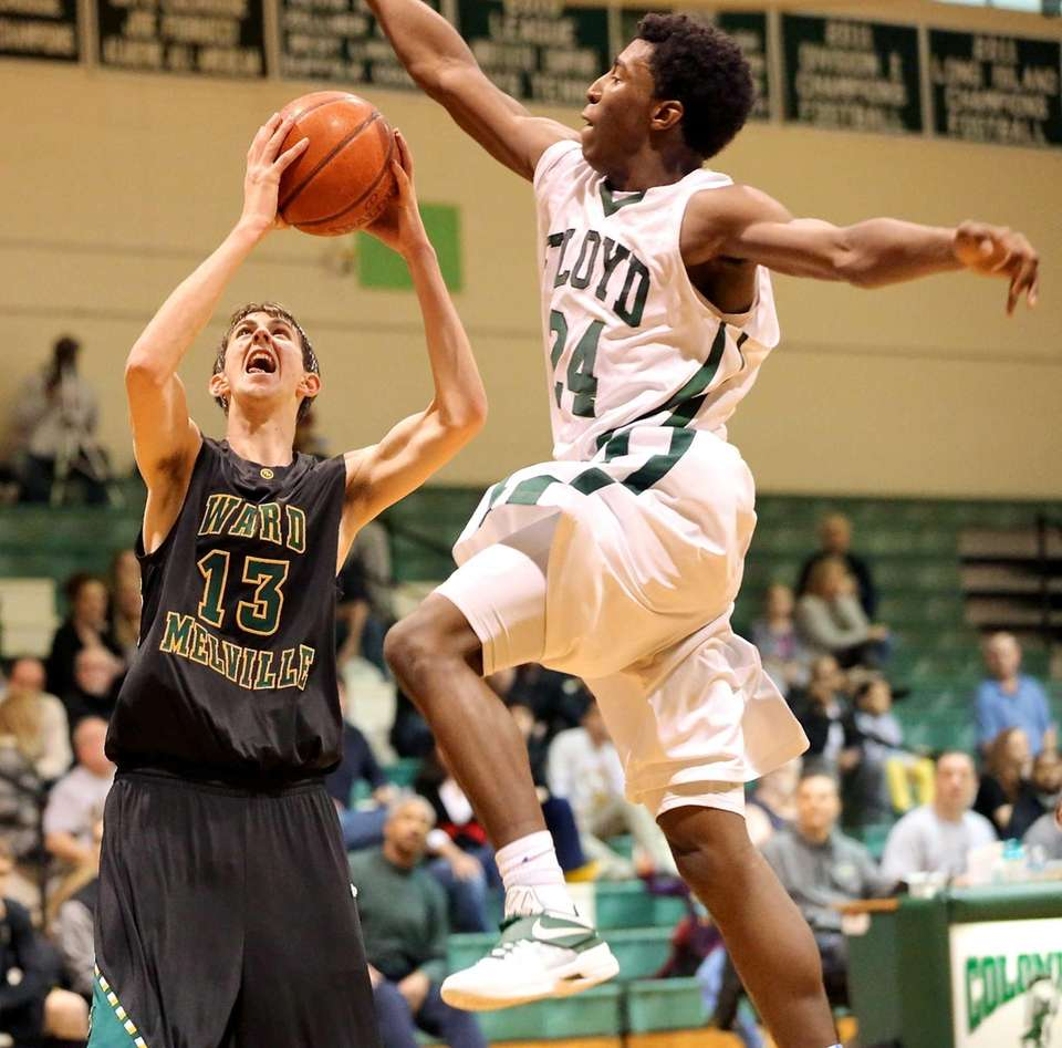 Ward Melville's Russell Winters looks to shoot as