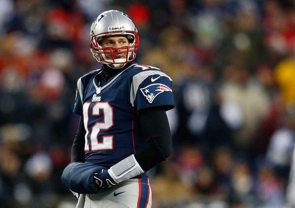 New England Patriots quarterback Tom Brady walks to