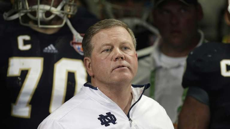 Notre Dame head coach Brian Kelly looks on