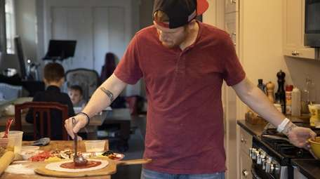 Jason Potter makes pizzas for his neighbors in