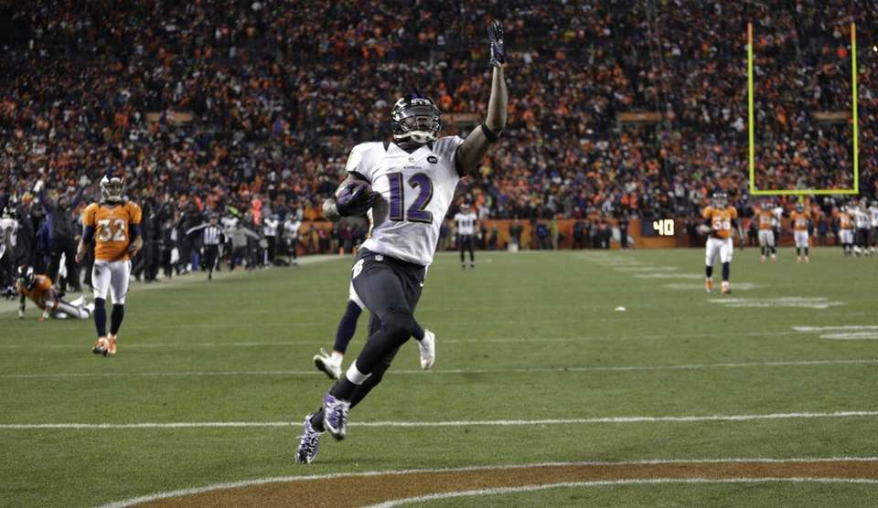 Baltimore Ravens wide receiver Jacoby Jones celebrates as