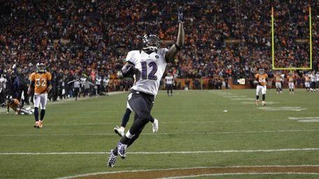 Baltimore Ravens wide receiver Jacoby Jones celebrates as