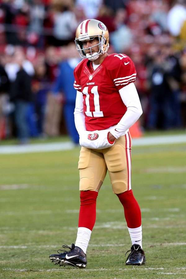 San Francisco 49ers quarterback Alex Smith looks on