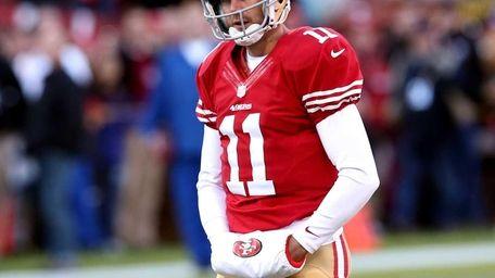 San Francisco 49ers quarterback Alex Smith looks on