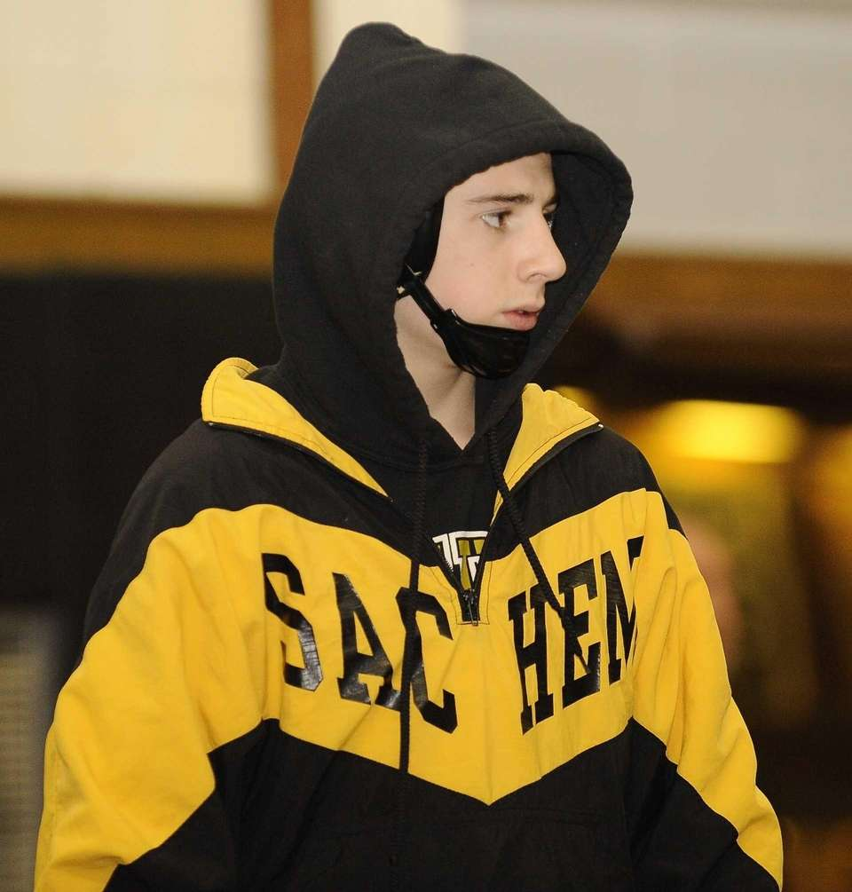Sachem North's Matt Stallone looks on from the