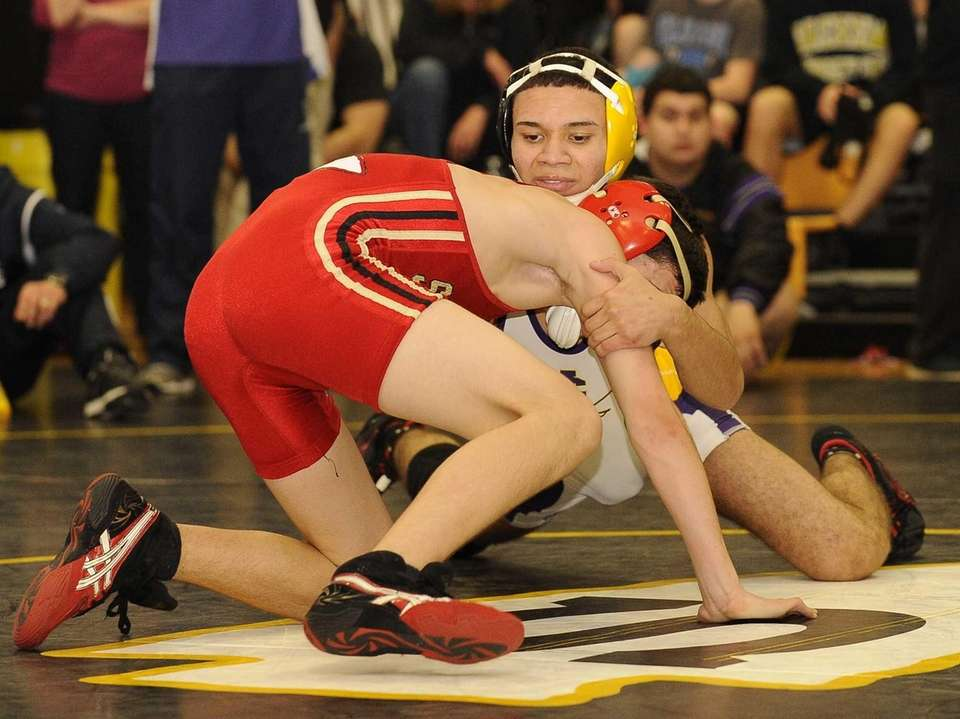 Central Islip's Mike Figueroa, facing, wins 10-2 against