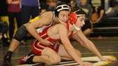 Central Islip's Mike Figueroa, left, wins 10-2 against