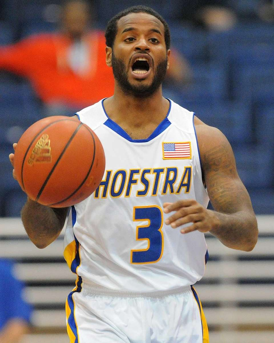 Hofstra's Stevie Mejia dribbles upcourt in the first