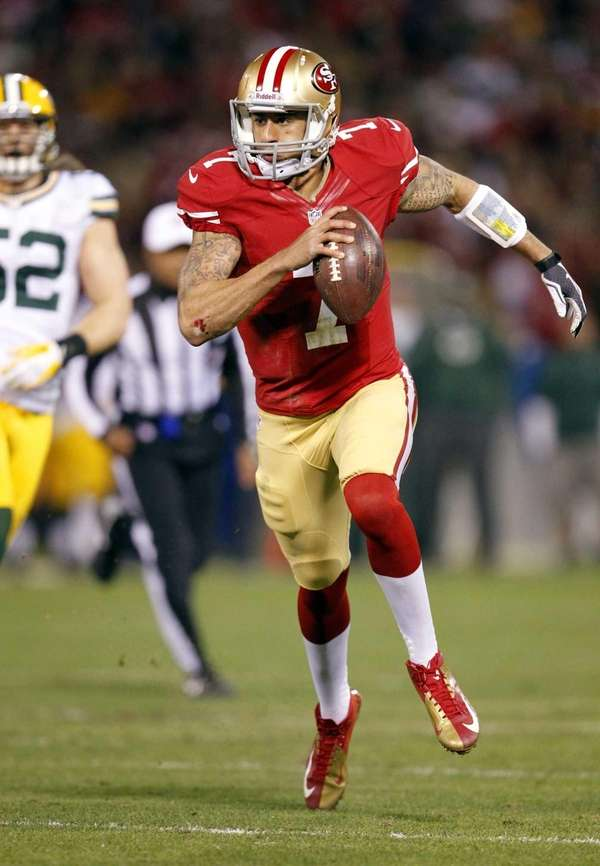 San Francisco 49ers quarterback Colin Kaepernick (7) runs for a 20
