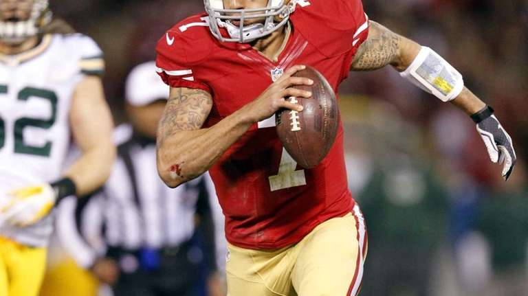 San Francisco 49ers quarterback Colin Kaepernick (7) runs