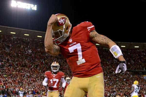 San Francisco 49ers quarterback Colin Kaepernick celebrates after