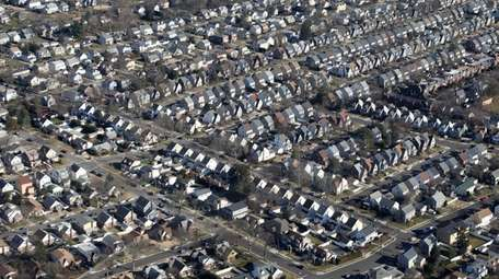 The Federal Housing Administration insures about 15% of