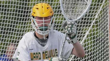 Collin Krieg #28 of Ward Melville defends the