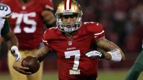 San Francisco 49ers quarterback Colin Kaepernick runs the