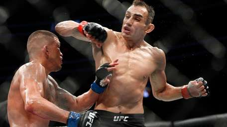 Tony Ferguson, right, fights Anthony Pettis during a