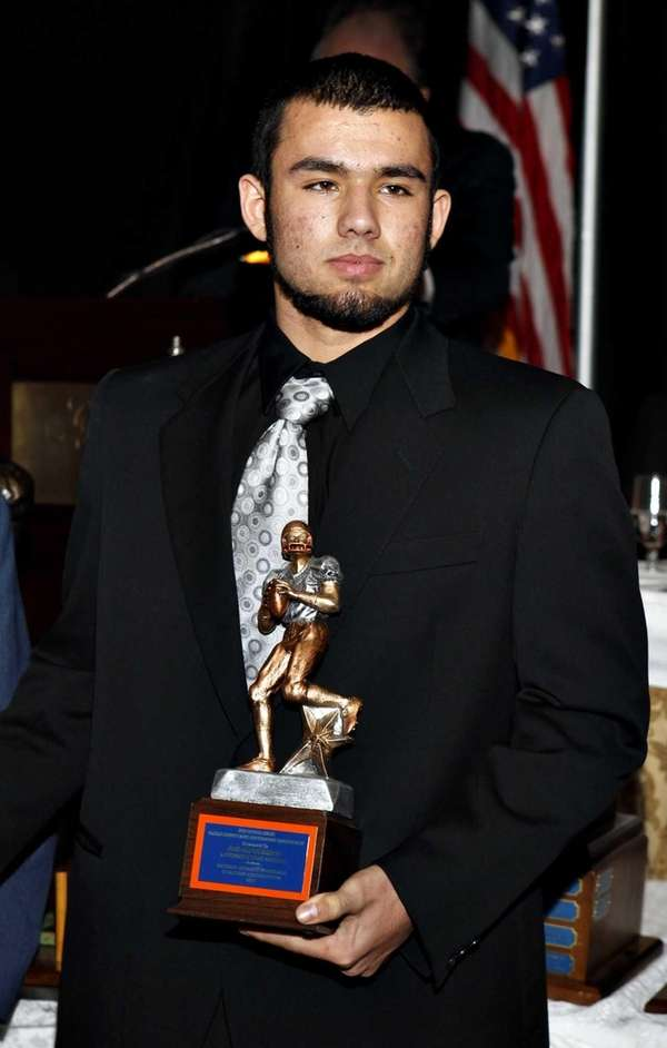 Lawrence quarterback Joe Capobianco stands with the 2012