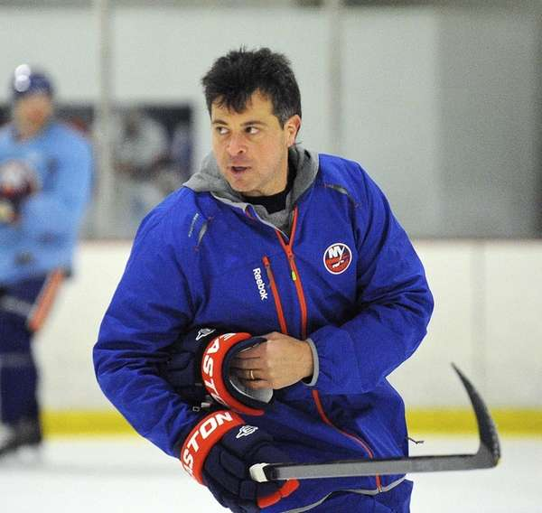 New York Islanders coach Jack Capuano skates during