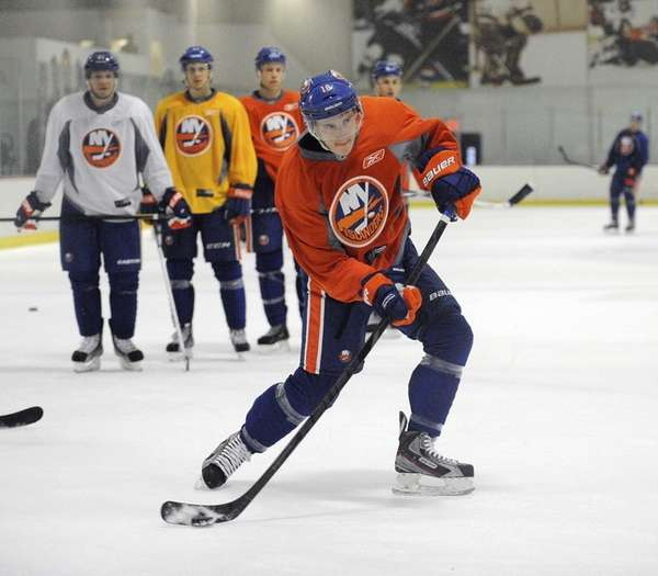Ryan Strome shoots the puck during the New