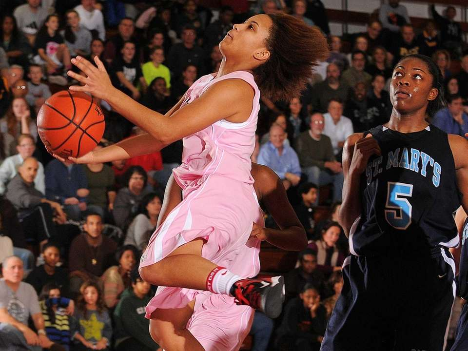Long Island Lutheran's Kaela Hilaire, left, leaps past