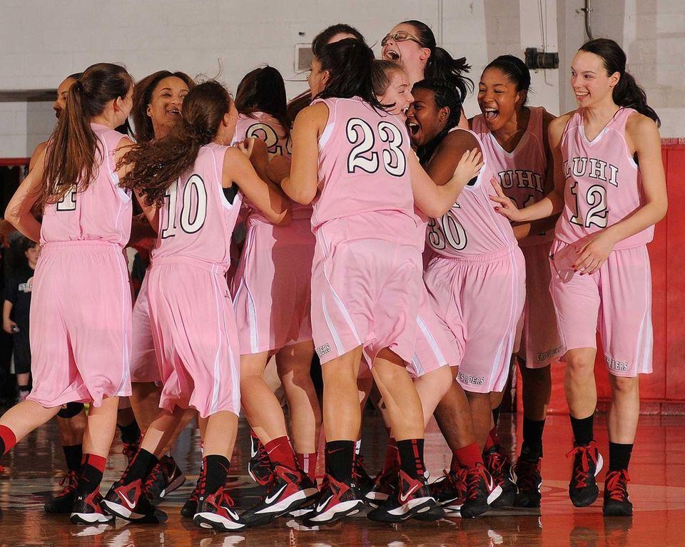 Long Island Lutheran girls basketball teammates celebrate after