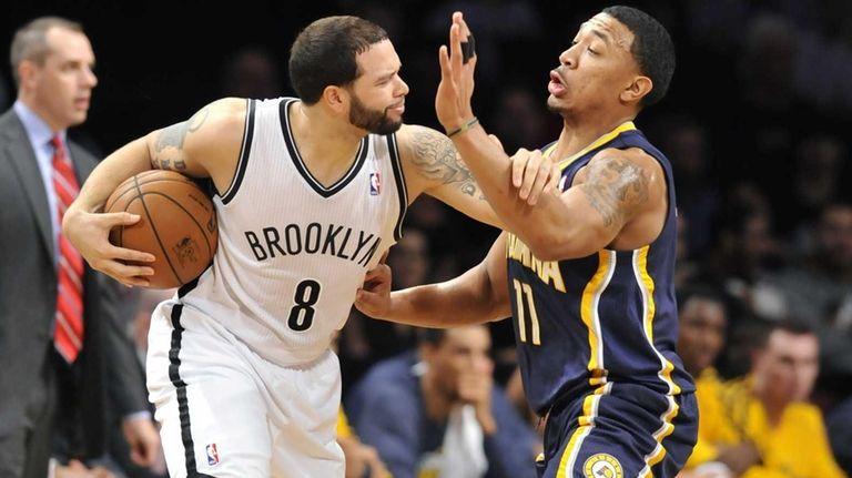 Deron Williams of the Nets keeps Orlando Johnson