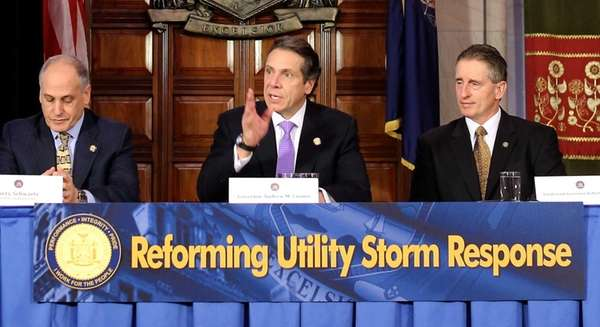 Governor Andrew Cuomo hears the preliminary report from