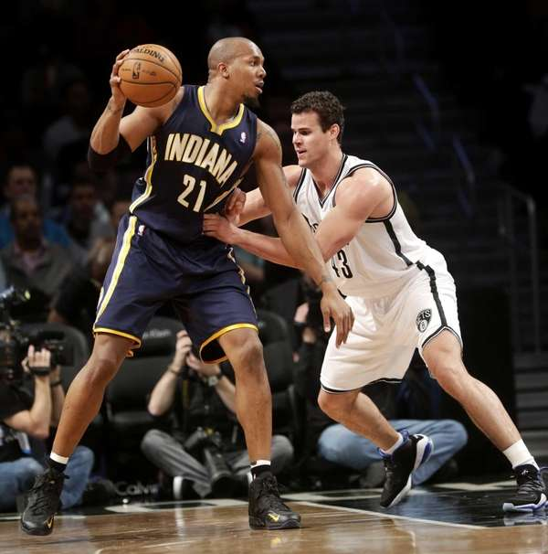 Brooklyn Nets' Kris Humphries, right, guards Indiana Pacers'