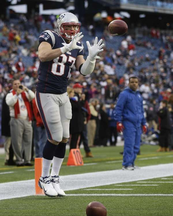 New England Patriots tight end Rob Gronkowski warms