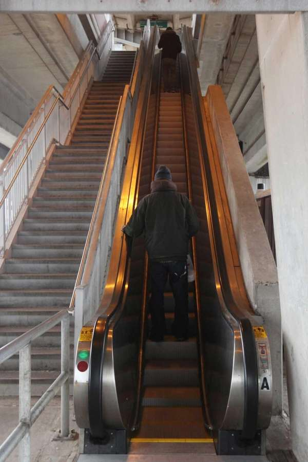 Long Island Rail Road passengers ride the escalator