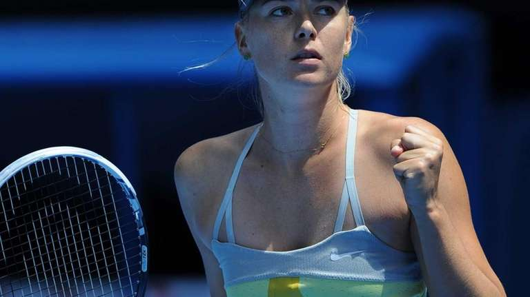 Russia's Maria Sharapova reacts after defeating Russia's Olga