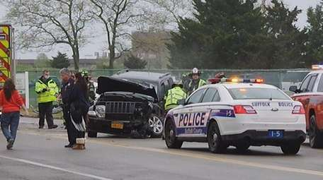 Officials at the scene of the two-car crash