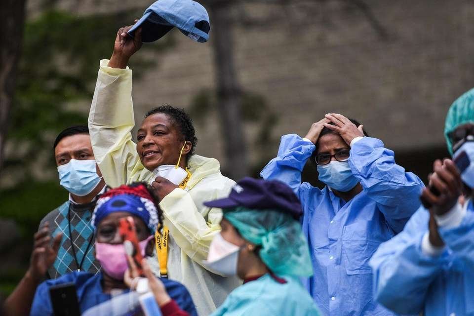 Healthcare workers celebrate as Barbara Holdin, of Roosevelt,