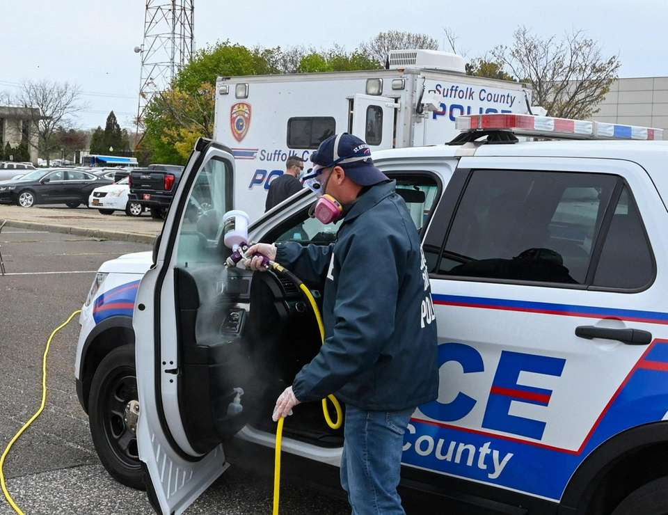 A Suffolk County police vehicle is decontaminated in