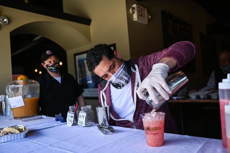 Co-Owner Dave Chiarella creates a pink taco cocktail