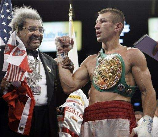 Boxing promoter Don King, left, congratulates Tomaz Adamek,