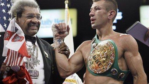 Boxing promoter Don King, left, congratulates Tomaz Adamek,