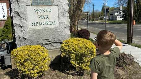 Alexander Boyd, 9, of Cutchogue, salutes at a