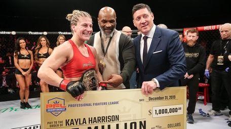 Kayla Harrison celebrates winning the PFL women's lighweight