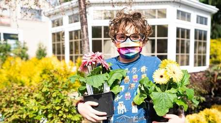 Maxwell Chertoff, 7, from East Norwich, shops with