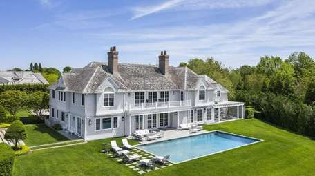This 9,800-square-foot shingle-style, waterfront home in Southampton has