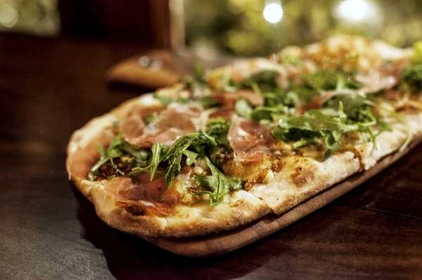 The Parma thin-crust pizza at Lula Trattoria in