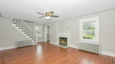 The house has hardwood floors and a wood-burning