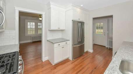 Renovations include a new kitchen with granite counters.